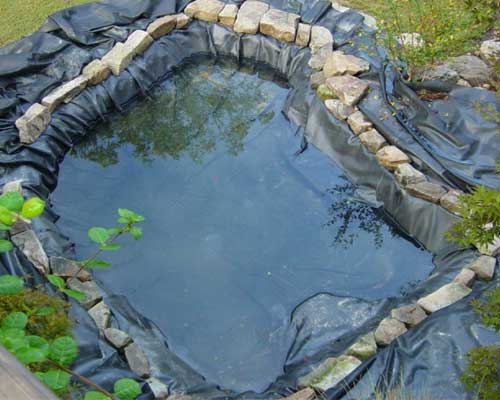 Pond liner with stones
